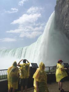 Walking underneath Niagara Falls.