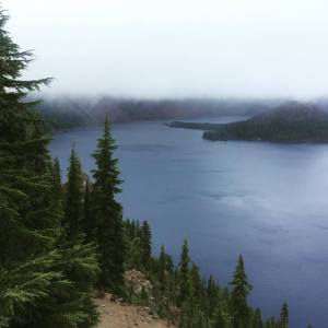 I visited Crater Lake, Oregon last week. It was beautiful, but dense fog and smoke from forest fires enveloped the mountain tops.